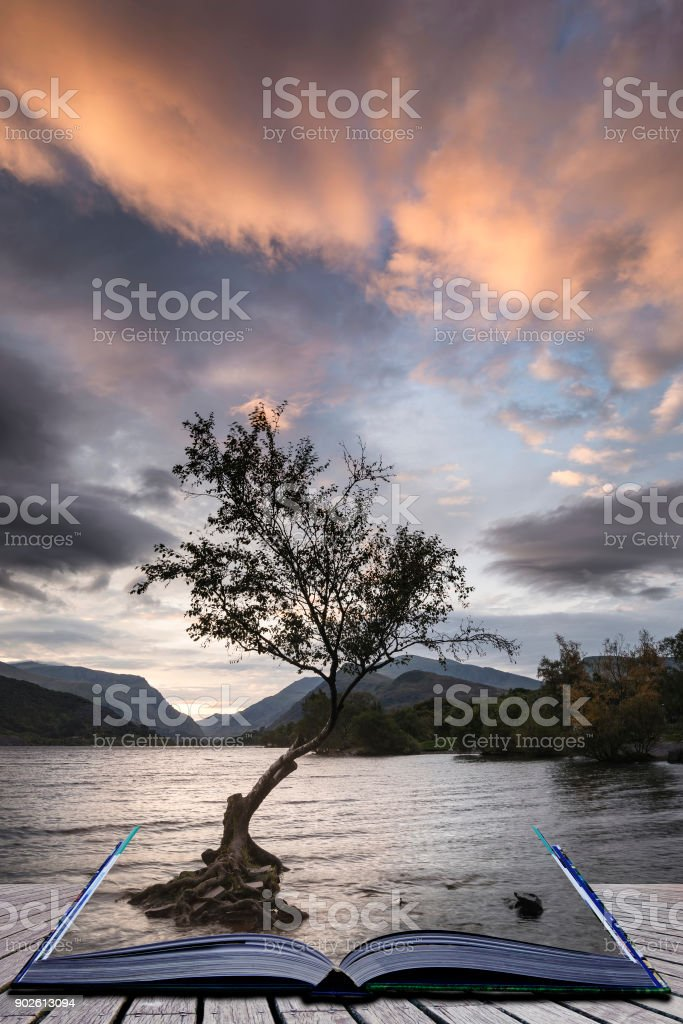 Beautiful landscape image of Llyn Padarn at sunrise in Autumn in Snowfonia National Park stock photo