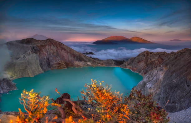 Beautiful Landscape mountain and green lake in the morning at Kawah Ijen volcano , East Java, Indonesia Beautiful Landscape mountain and green lake in the morning at Kawah Ijen volcano , East Java, Indonesia kawah ijen stock pictures, royalty-free photos & images