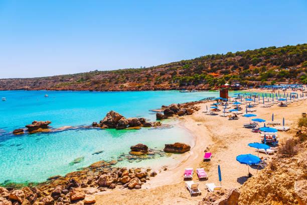 beautiful landscape near of nissi beach and cavo greco in ayia napa, cyprus island, mediterranean sea. amazing blue green sea and sunny day. - cyprus стоковые фото и изображения