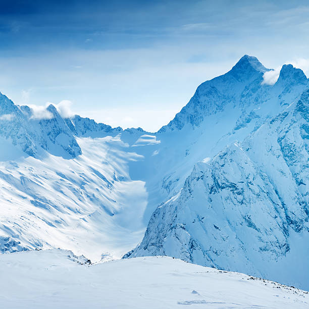beautiful landscape of caucasus mountain, covered peaks dombaj, - snowy mountains stock photos and pictures