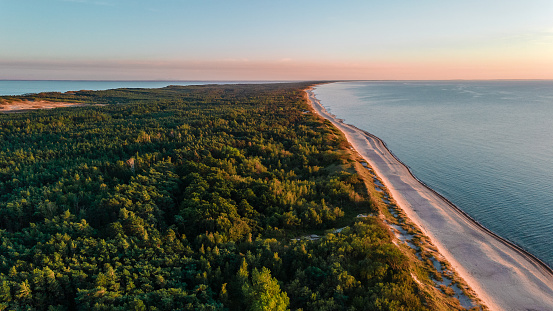 Beautiful landscape of Curonian spit on the Baltic sea with forest, beach and sea at sunset. aerial shot from drone. nature photography