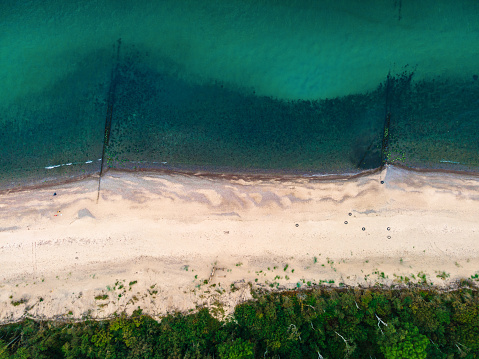 Beautiful landscape of Curonian spit on the Baltic sea with forest, beach and sea. aerial shot from drone