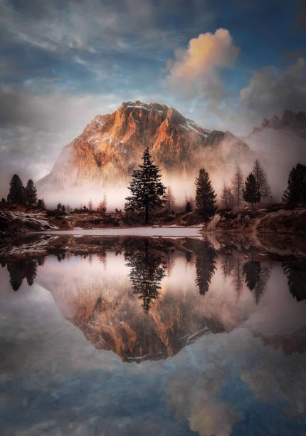 Beautiful landscape of Falzarego Pass Lake Limides Beautiful landscape of Passo di Falzarego Lago di Limides trees in mist stock pictures, royalty-free photos & images