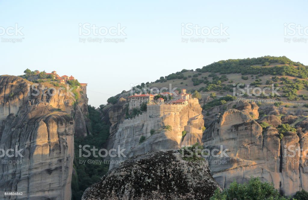 Beautiful landscape of Meteora at sunrise. Monastery of Varlaam an Great Meteoron. Central Greece. stock photo