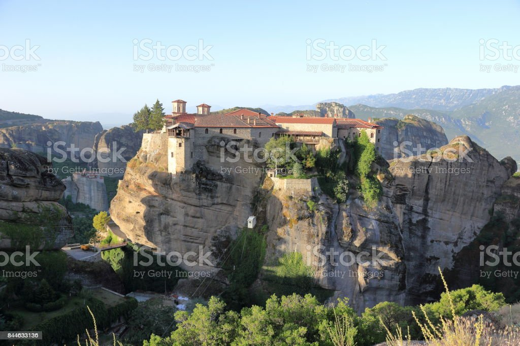 Beautiful landscape of Meteora at sunrise. Monastery of Varlaam. Central Greece. stock photo