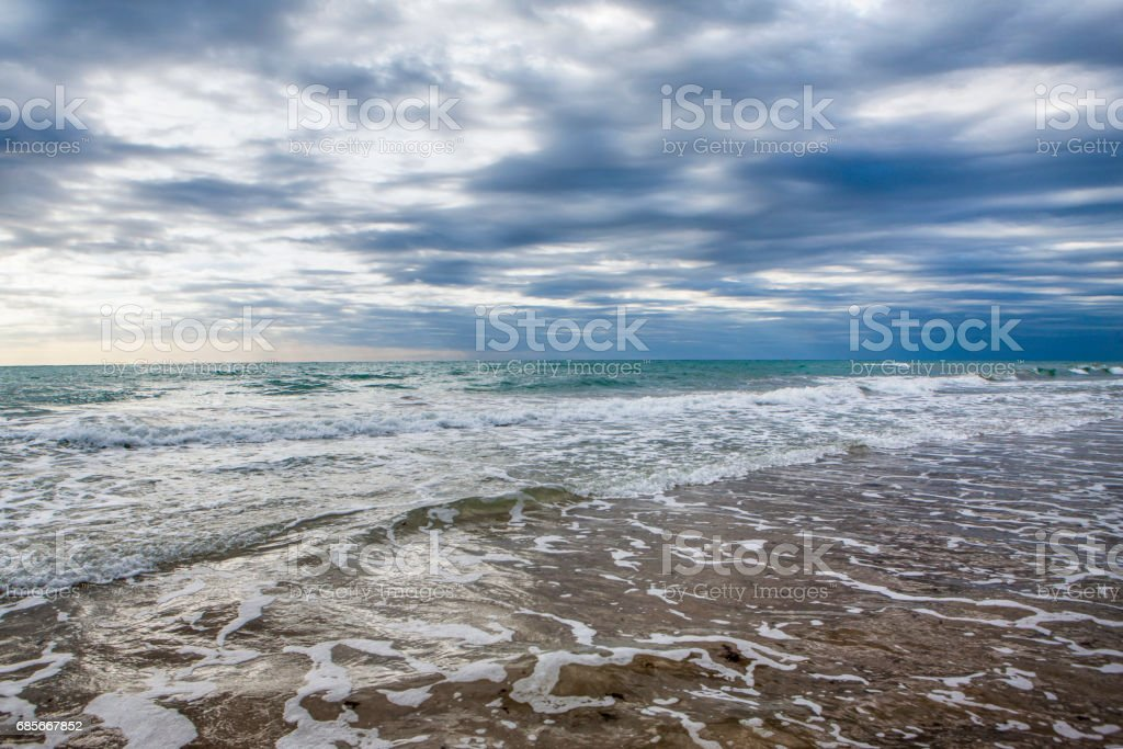 Beautiful landscape of sandy beach on the Atlantic coast on sunset, Portugal royalty-free 스톡 사진