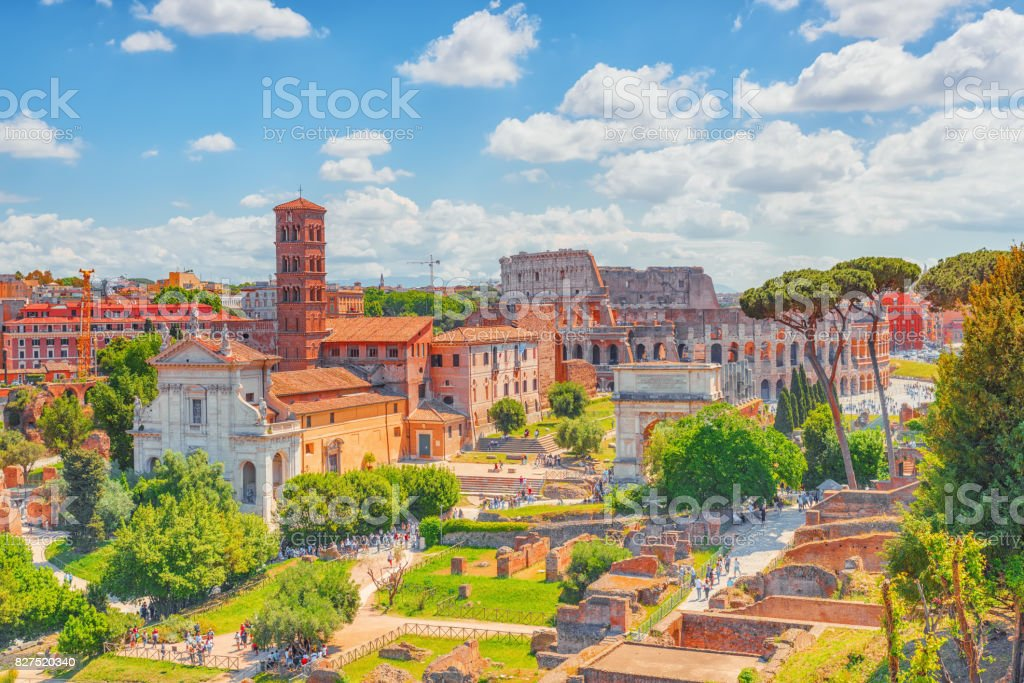 Beautiful landscape of the Colosseum in Rome and Roman Forum- one of wonders of the world  in the morning time. stock photo
