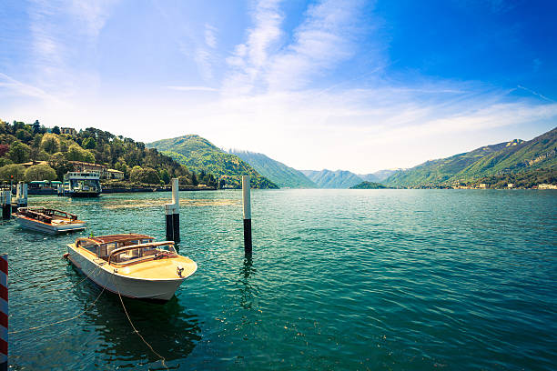 beautiful landscape on como lake and boats, italy - lake como stock photos and pictures