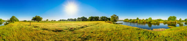 Beautiful landscape Landscape in summer with trees, meadows, river and sun lower saxony stock pictures, royalty-free photos & images