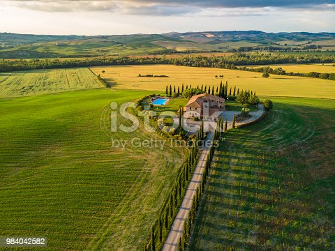 Beautiful landscape scenery of Tuscany in Italy - cypress trees along white road - aerial view -  close to Pienza, Tuscany, Italy