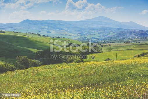 Beautiful landscape, spring nature. Mountain landscape. Top view of sunny fields on the hills in Tuscany, Italy