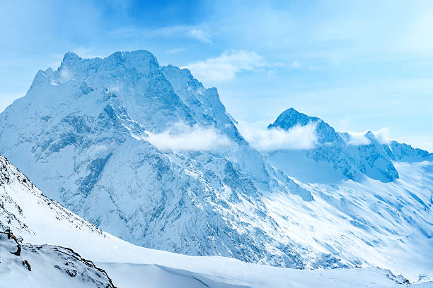 beautiful landscape winter snow covered of dombaj mountain peaks - snowy mountains stock photos and pictures
