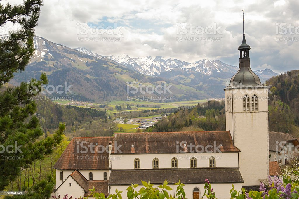 Beautiful landscape with Alps mountains and cementery, Gruyeres, Switzerland. stock photo