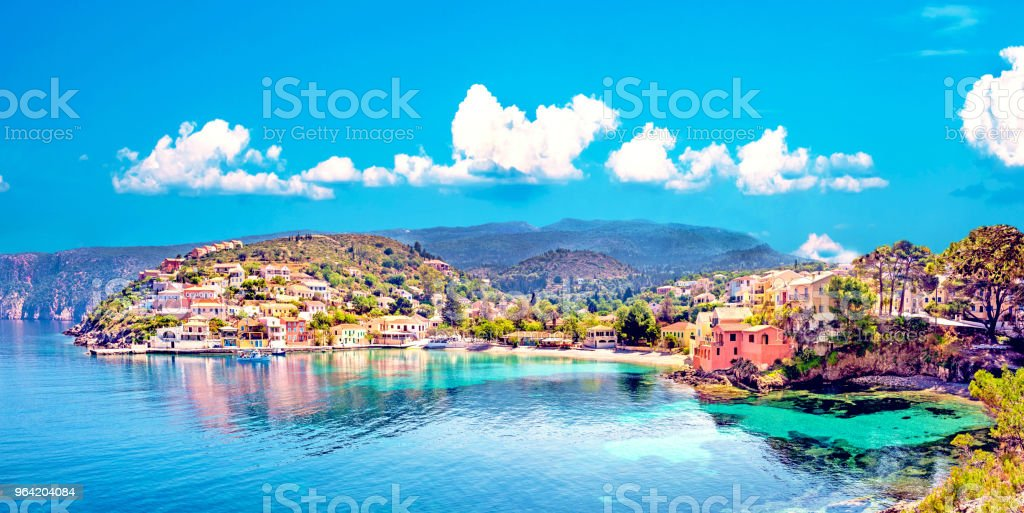 Beautiful landscape with bay and colorful buildings on the background of picturesque clouds in the town of Asos, Greece, Kefalonia. Wonderful exciting places. Panorama. stock photo