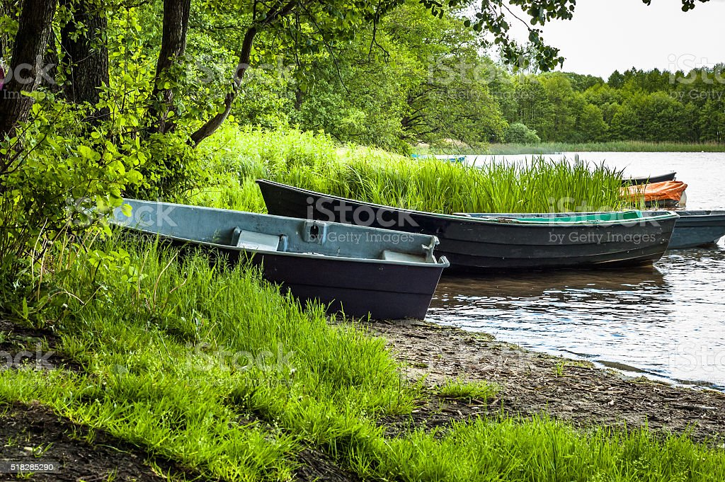 Beautiful landscape with boats on the lake at the shore stock photo