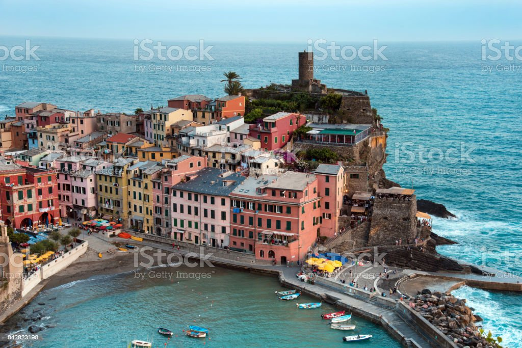 Beautiful landscape with colorful houses and boats on the cliffs in Vernazza, Cinque Terre, Italy, Europe. Vintage style. stock photo