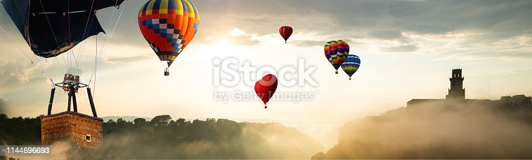 844061492 istock photo Beautiful landscape with hot air balloons. 1144696693
