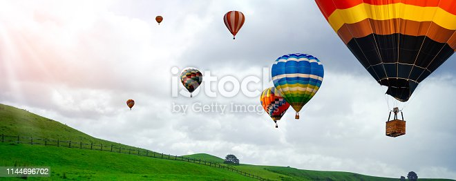 844061492 istock photo Beautiful landscape with hot air balloons. 1144696702