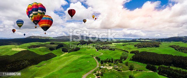844061492 istock photo Beautiful landscape with hot air balloons. 1144696706