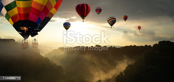844061492 istock photo Beautiful landscape with hot air balloons. 1144696712
