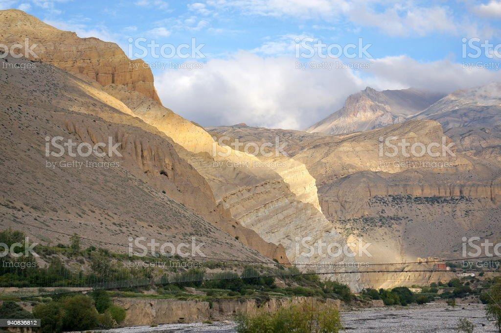 Beautiful landscape with Pedestrian suspension bridge over the Kali Gandaki River. stock photo