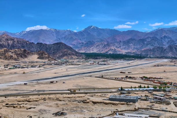 Beautiful landscape with snow capped Himalaya mountains and  a Leh airport in Ladakh, India . stock photo