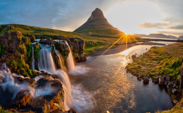 Beautiful landscape with sunrise on Kirkjufellsfoss waterfall and Kirkjufell mountain, Iceland. stock photo