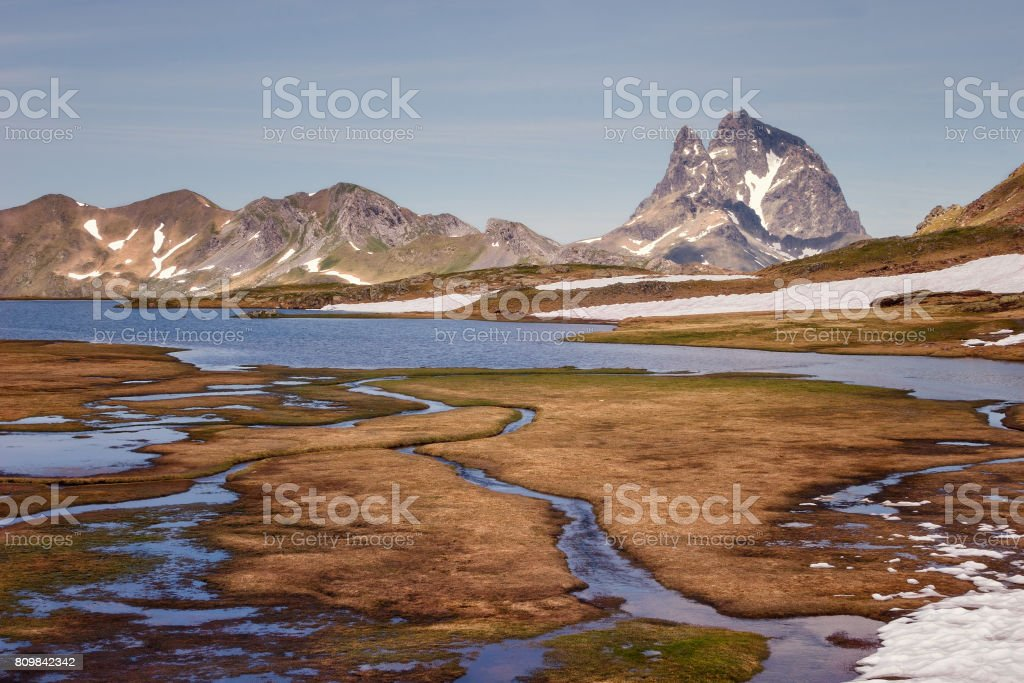 Beautiful landscape with the Midi d'Ossau peak in background, Parc national des Pyrenees, Spain. stock photo
