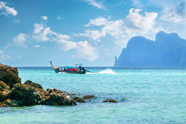 Beautiful landscape with traditional boat on the sea in Phi Phi region, Thailand. stock photo