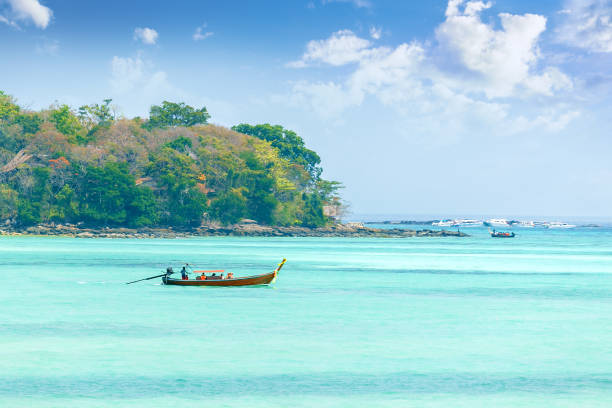 Beautiful landscape with traditional boat on the sea in Phi Phi region, Thailand stock photo