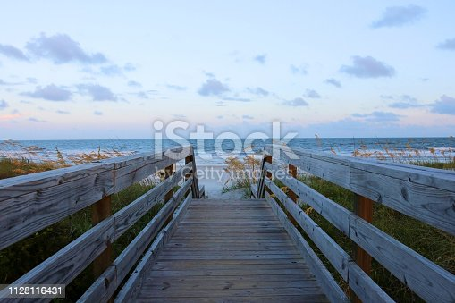 Wooden boardwalk and stairs to the Atlantic ocean beach over sand dunes in Huntington Beach State Park, Myrtle Beach area, SC, USA.