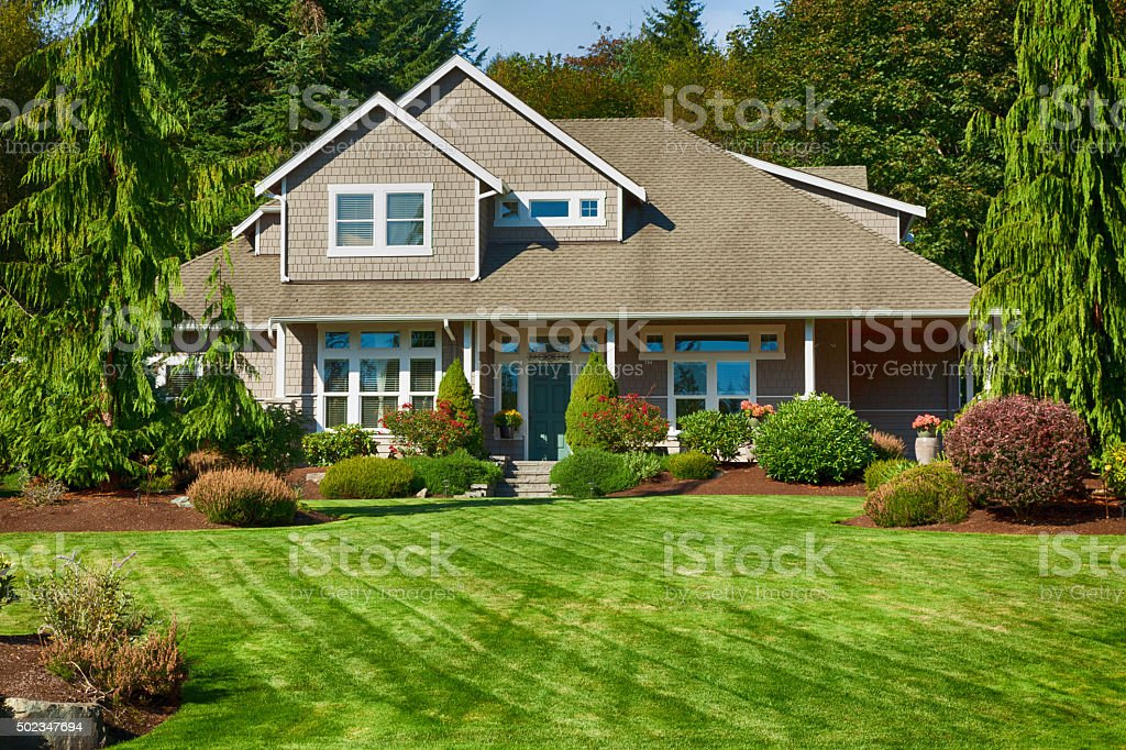 Beautiful landscaped upscale home stock photo