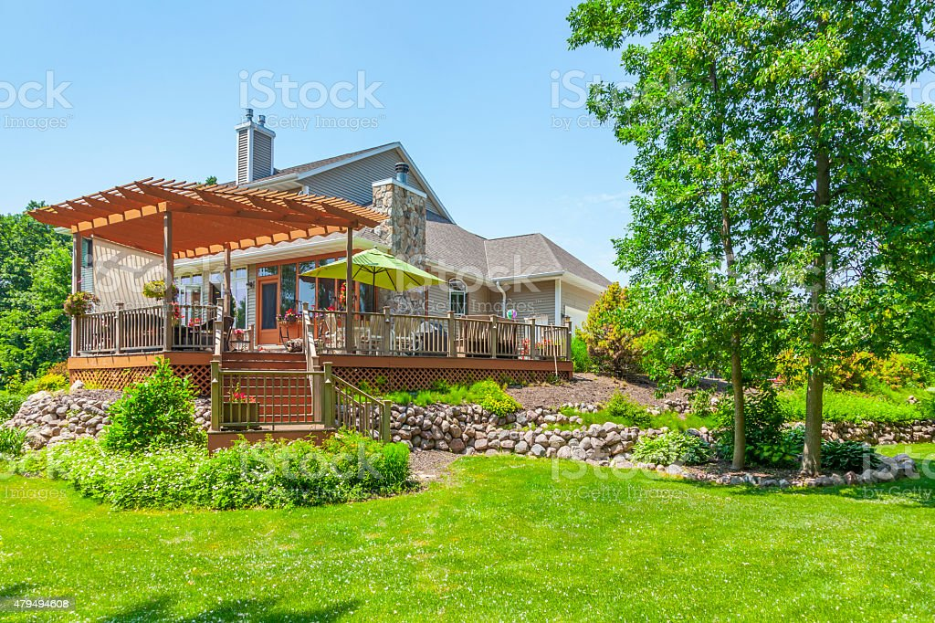 Beautiful Landscaped Yard and Deck with Pergola stock photo