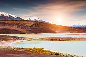 Volcanoes and high-altitude lagoon on plateau Altiplano, Bolivia. South America landscapes
