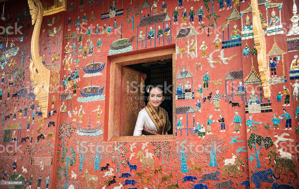 Beautiful Laos lady in traditional costume at Luang Prabang stock photo