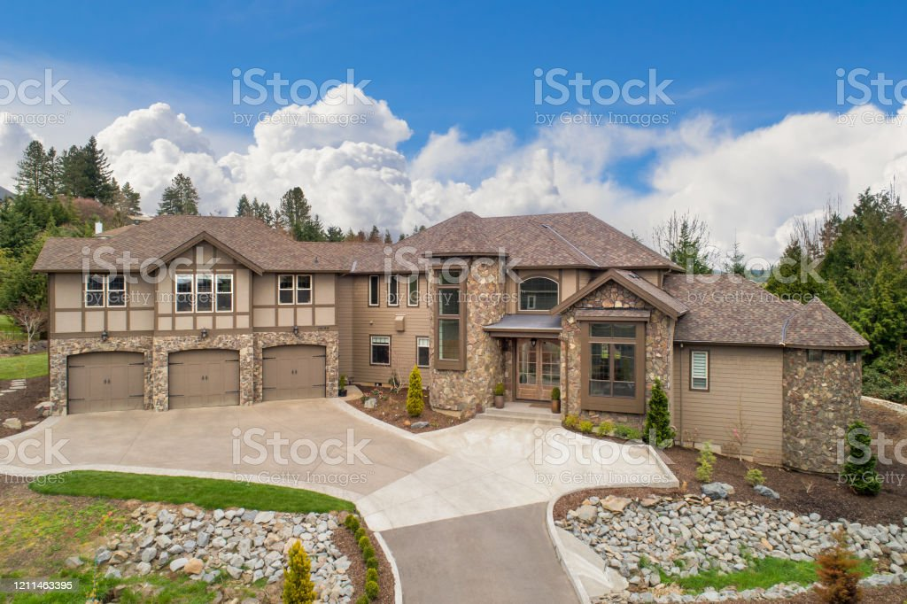 Beautiful Large Luxury Home Exterior On Bright Sunny Day With Blue Sky Features Three Car Garage Turret And Elegant Design Stock Photo Download Image Now Istock