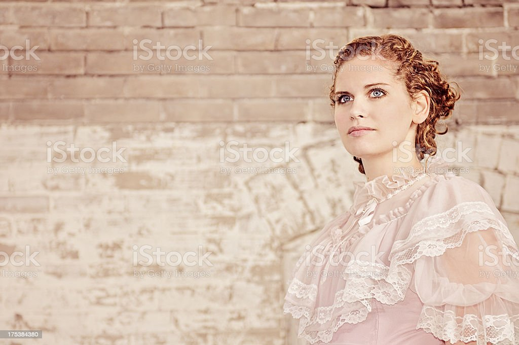 Beautiful Late 1800s Woman In Pink Ruffled Dress stock photo