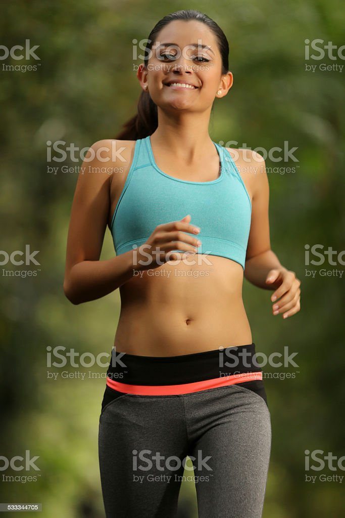 Beautiful latin american running stock photo