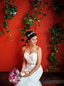 Beautiful latin bride sitting and looking away
