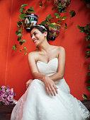 Beautiful latin bride sitting and smiling away