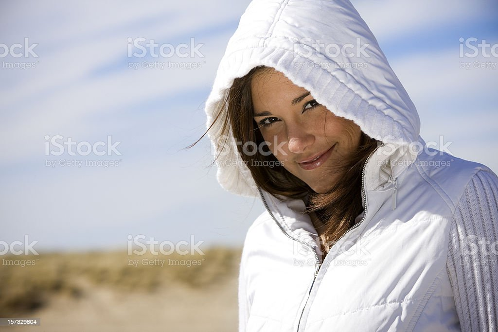 Beautiful Latina Young Woman Portrait at Beach in Hoodie, Copyspace royalty-free stock photo