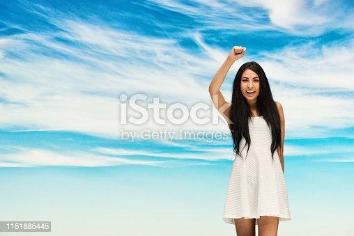 Beautiful cute latino female wearing nice white dress