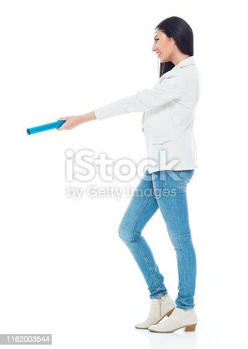 Beautiful latino female standing on white background