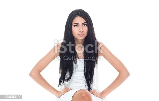 Attractive latino female wearing a white dress