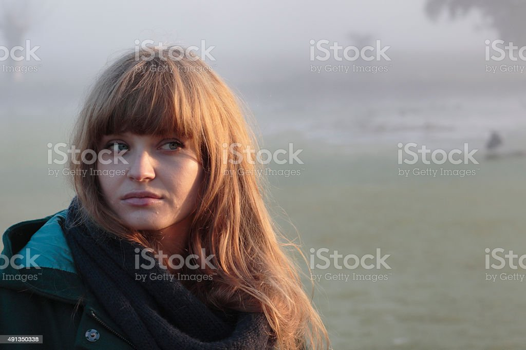 Foggy autumn Latvian outdoor girl model head and shoulders stock photo