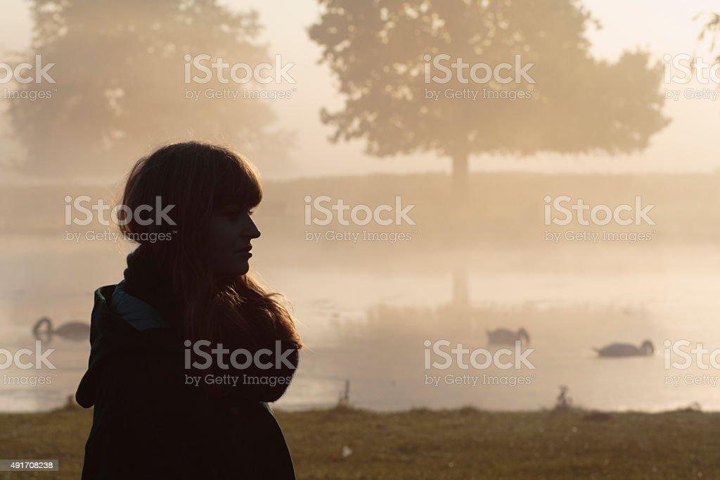 Foggy autumn landscape Latvian outdoor girl model stock photo