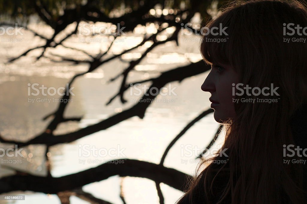 Profile beautiful Latvian outdoor girl by foggy river stock photo