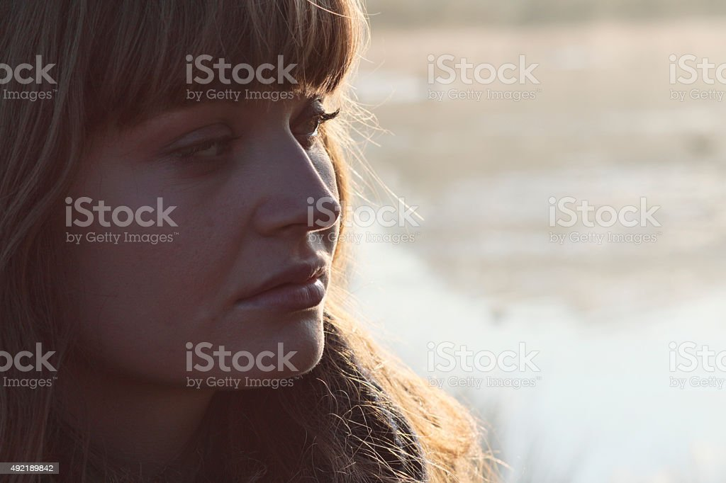 Close up beautiful Latvian outdoor girl by foggy river stock photo