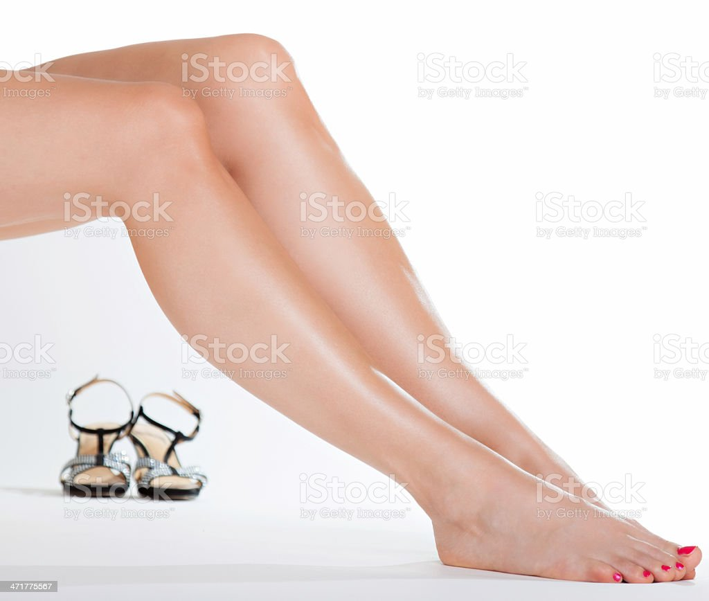 Beautiful legs and a pair of high heels royalty-free stock photo