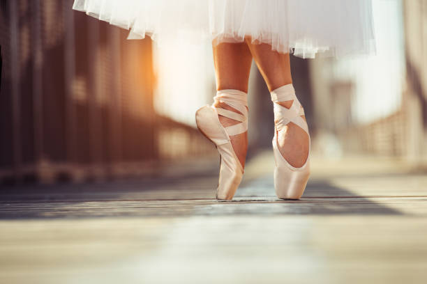 beautiful legs of female classic ballet dancer in pointe stock photo